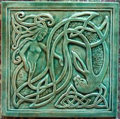 Decorative handmade ceramic tile: Handcrafted, relief carved Celtic mermaid ceramic tile