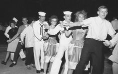 Dancing in the street at the parade, 1962.