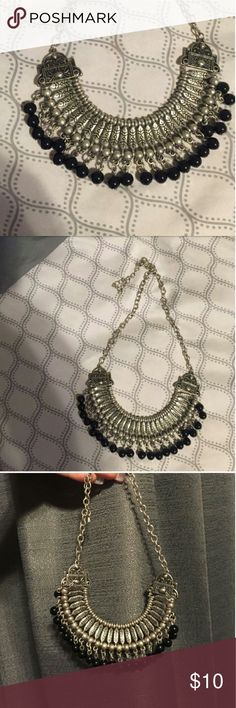 Forever 21 boho style necklace Beautiful silver and black beaded boho style necklace from forever 21 only worn once for short time. Perfect statement jewelry piece to accesorize with anything. Forever 21 Jewelry Necklaces