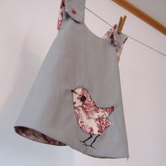 Reversible gray and red toile pinafore dress by allthenumbers