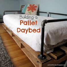 Painted Therapy: Building a Pallet Daybed...this could be great alt for couches in basement/playroom