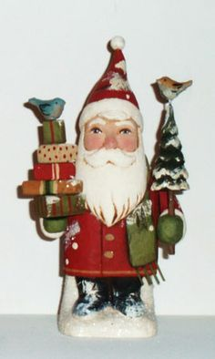 "Santa W/ Trees and Gifts  Greg Guedel  7.5"" Tall  Wood carving  $280.00"