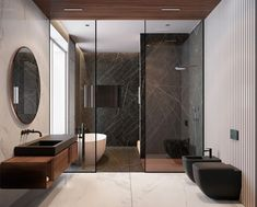 O mármore escuro é um ótimo pedido para quem gosta de ambientes sóbrios e sofisticados! Usado neste banheiro, ele criou um contraste bem elegante com a madeira! #BathroomToilets