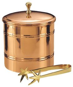 $49.00-$44.00 This décor copper ice bucket is a great way to make a good impression on any guest. The brass tongs are a beautiful contrast against the copper.