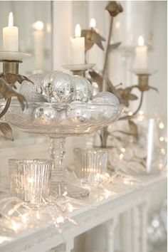 Silver an goal mixed in a holiday decora!!! Bebe'!!! Add a clean white background with candlelight and you have a very festive mantel!!!