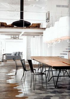 Contemporary Living Room Ideas! I love how they treated the floor using something more dining friendly under the table.
