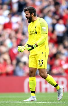 Alisson of Liverpool celebrates his team's second goal, scored by Sadio Mane (not pictured) during the Premier League match between Liverpool FC and West Ham United at Anfield on August 2018 in Liverpool, United Kingdom. Liverpool Anfield, Liverpool Football Club, Premier League Soccer, Premier League Matches, Football Celebrations, Russia World Cup, Sports Clubs, Goalkeeper, Football Players