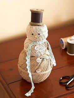 I love him! Fun way to use up old thread and twine I usually see in the thrift stores.
