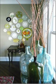 vintage wine bottles and mismatched plates..for a similar look try the Lady Jane Vases from Willow House