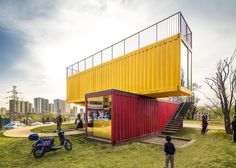 People's Architecture Office has used 12 shipping containers to build a temporary, red and yellow pavilion in a fast-growing town in China's Shanxi province