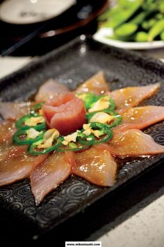 Canadian Albacore Flower (Taro's by Mikuni): Thin slices of albacore tuna with crispy garlic chips, thinly sliced jalapeno peppers, and special sauce