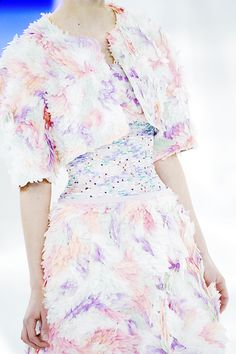 details to die for↳chanel s/s '14 | dresses [III/III] Intricate embellishments such as beading in pretty pastel shades, detailed patterns made from shimmering sequins, and tiny twinkling gems are present creating a fairy-like look on the corseted waist of a dress which featured in the Chanel Haute Couture Spring/Summer 2014 collection.