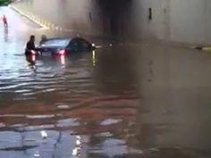 Após forte chuva, motorista fica preso em carro e é resgatado em MG +http://brml.co/1ONYHdW