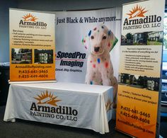 Large and small retractable banners with table cloth to match. Matching trade show tablecloths and banners look consistent and show company branding. #branding #tradeshow #marketing