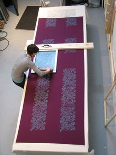 Roisin Fagan printing repeating patterns in Halifax studio.