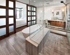 VOC Design group-great luxury bath. Natural materials,free standing tub, glass walk thru shower, zen, spa