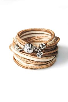 A classic leather wrap with a strong metal clasp is a pertinent part of any carefree woman's wardrobe.