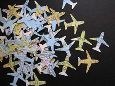 airplane shapes punched out of map paper -- fun confetti with travel theme