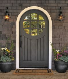 DOOR COMPANY to fix front door? This custom-made garden door created by Great Northern Door Company in Savage, Minnesota makes a huge first impression at this cottage-style lake house built by the Lands End Development company. Arched Front Door, Front Entrances, Arched Doors, Front Entry, Door Design, Exterior Design, House Design, Door Entryway, Entry Doors