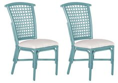 With their wrapped joints and wonderfully woven seat backs, these bright rattan Light Blue Lilly Side Chairs will bring a breezy, tropical look to your dining room. Set of 2. $350 Sale $279.