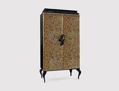 ORCHIDEA has a cabinet design featured in black and gold, inspired by elegance and extravagance which turns it into a luxurious storage cabinet.