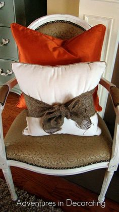 tie burlap bows on front porch pillows for fall