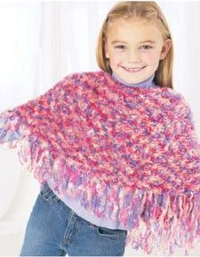 Follow this free knit pattern to create a child's poncho using Bernat Boa eyelash yarn.