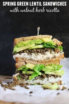 Spring green lentil sandwiches with walnut herb ricotta recipe! Delicious, vegetarian sandwiches with french green lentils, cucumber, avocado, and a walnutty herby ricotta cheese. The perfect healthy lunch or dinner recipe! Vegetarian Lunch, Vegetarian Sandwiches, Vegetarian Recipes, Healthy Recipes, Yummy Recipes, Healthy Sandwiches, Lentil Recipes, Yummy Food, Delicious Sandwiches