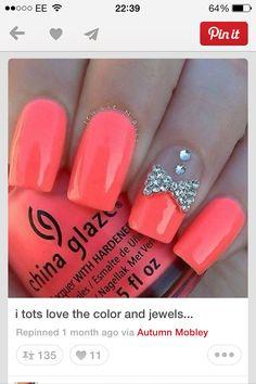 Bright orange nails with diamonds