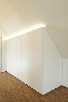 This dressing room consists of an open, central wardrobe. - lamp ideas - This dressing room consists of an open central wardrobe. Furthermore, this dressing room consists o - Attic Bedroom Storage, Loft Storage, Attic Rooms, Attic Spaces, Bedroom Loft, Bedroom Decor, Eaves Storage, Wardrobe Design, Built In Wardrobe