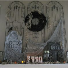 These cemetery gates are fantastic! I love how they provide just the perfect spooky backdrop to the creepy mantel décor!