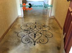 Stained concrete textured overlay with Modello personal design in entryway by Texoma Concrete Effects, Iowa Park, TX