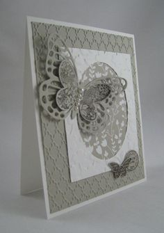 March 18, 2015 Miechelle Weber: Stampin' Up! Something Borrowed DSP, Ovals Collection Framelits, Fancy Fan and Spring Flowers Embossing Folder, Butterfly Basics, Butterflies Thinlits