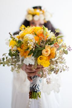 yellow bohemian bouquet // photo by Jennifer Young // florals by Viva Voce // View more: http://ruffledblog.com/bohemian-los-angeles-wedding/
