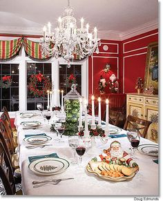 The red walls with elegant white trim offer a picturesque backdrop for a holiday feast. Candlelight, classic Spode Christmas tree china and a glass apothecary jar full of gleaming green ornaments add the finishing touches to this elegant tablescape.