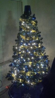 Police Christmas Tree. I may have to do this to the tree in family room next year. Ha!
