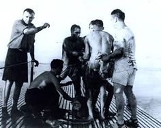 USS Sealion (SS-315). British and Australian Prisoners of War rescued by Sealion on 15 September 1944. They had been on board the Japanese transport Rakuyo Maru en route from Singapore to Japan when it was sunk in an attack by the submarine on 12th of September. National Archives photograph, 80-G-281718.