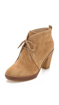 KORS Michael Kors lace up booties, $295.