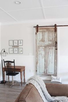 This is the story of how my vintage chippy antique door finally founds it's home on a piece of rustic looking barn door hardware in our new home.