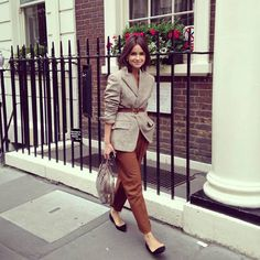 Miroslava Duma in Castello D'Oro jacket, Etro trouser, Giorgio Armani shoes and Prada bag
