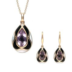 W Hamond 18ct Rose Gold Whitby Jet Diamond Amethyst Mother of Pearl Two Piece Set A perfect gift for a loved one, this set has been created using the finest hand crafted Whitby Jet. The design features a central faceted amethyst gemstone which is framed in 18ct rose gold. Each piece is set with Whitby Jet and white mother of pearl in a stunning curved patterned that surrounds the amethyst, with a sparkling 0.01ct brilliant cut diamond completing this eye catching and individual design. The… Christmas Gift Sets, Two Piece Sets, Amethyst Gemstone, Jewelry Packaging, Personalized Jewelry, Jet, Rose Gold, Drop Earrings, Gemstones