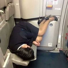 Female Flight Attendant laying down