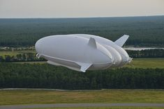 Test flight: An earlier incarnation of the vessel, built for the US Army, is pictured flyi...