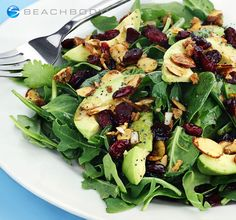 We love sweet and tart dried cranberries paired with creamy avocado in this delicious salad. Poppy seeds give it extra texture and peppery flavor. // almonds // avocado // nuts // salad // spinach // vegetarian // healthy recipes // Beachbody // BeachbodyBlog.com