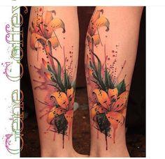 Watercolor tattoo, flower tattoo, lilies, lily tattoo, calf tattoo artist:gene Coffey Brooklyn/queens