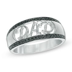 """Make Dad's day with this handsome diamond ring, customized especially for him. Fashioned in sterling silver, this sparkling band features the word """"DAD"""" spelled out across the style in an open stylized uppercase font. Borders of shimmering enhanced black diamonds line the ring's top and bottom, completing this elegant design. A look Dad will treasure, this ring captivates with 0.09 ct. t.w. of diamonds and a bright polished shine. Custom-made to fit his ring size. Sterling silver rings…"""