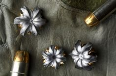 Hollow-point bullets after being shot underwater. So pretty!