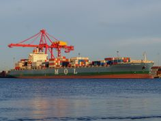 https://flic.kr/p/tMmvxL   MOL Emissary   The container ship, MOL Emissary [IMO 9407158] alongside the Patrick Stevedores operated No. 10 NQ berth June 16, 2015  IMO number: 9407158 Name of ship: MOL Emissary Previous names: None Call Sign: VRFX6 MMSI: 477627300 Gross Tonnage: 54,940 DWT: 67,000 Type of ship: Container Ship Built: 2009 Flag: Hong Kong, China Funnel Marks: MOL Ship Manager: Mitsui OSK Lines Ltd Beneficial Owner: Seaspan Corp