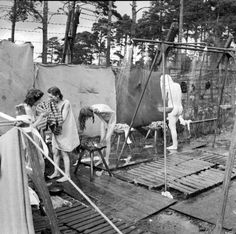 Newly liberated female inmates at Bergen-Belsen concentration camp shower in a Mobile Bath Unit equipped with hot water which was set up by the British after the camp was liberated on 15 April 1945 by the British 11th Armored Division. For many, this...