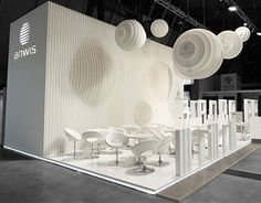 Shape of Anwis logo → round forms , sunlight comming through palm leaves→ untouachable beauty and funtional space at R+T Stuttgart.Different materials were used in construction of the stand: mdf plate as a main material, wooden pannel on the floor. Roun…